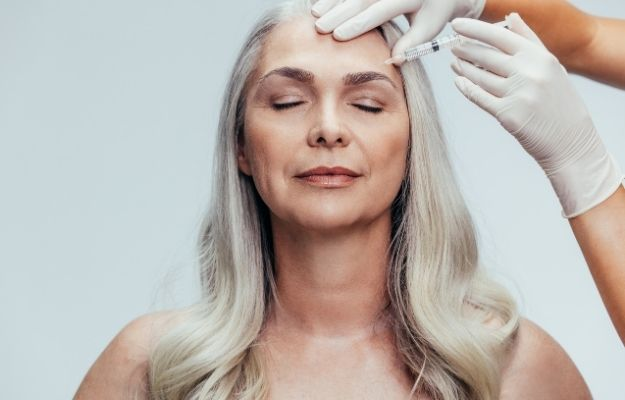 a woman having botox injection in her forehead | Botox | 7 Different Saggy Skin Solutions
